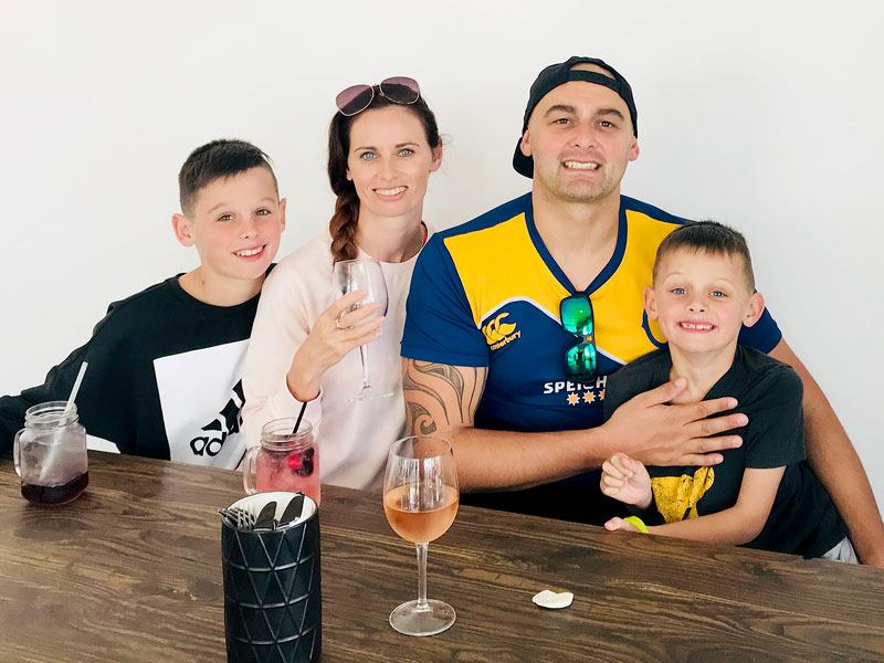 Nicky and Tony Kramers with their children Isaac, 11, Lucas, 8, pictured during their family holiday to Mount Maunganui after winning the Master Franchisee of the Year Award.