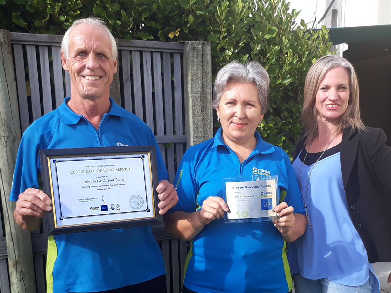 Robertus and Laima Vork receive their Certificate of Long Service from Abby Latu.