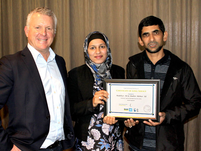 Mukthar Ali and Shahin Akthar Ali receive their seven-year long service award.