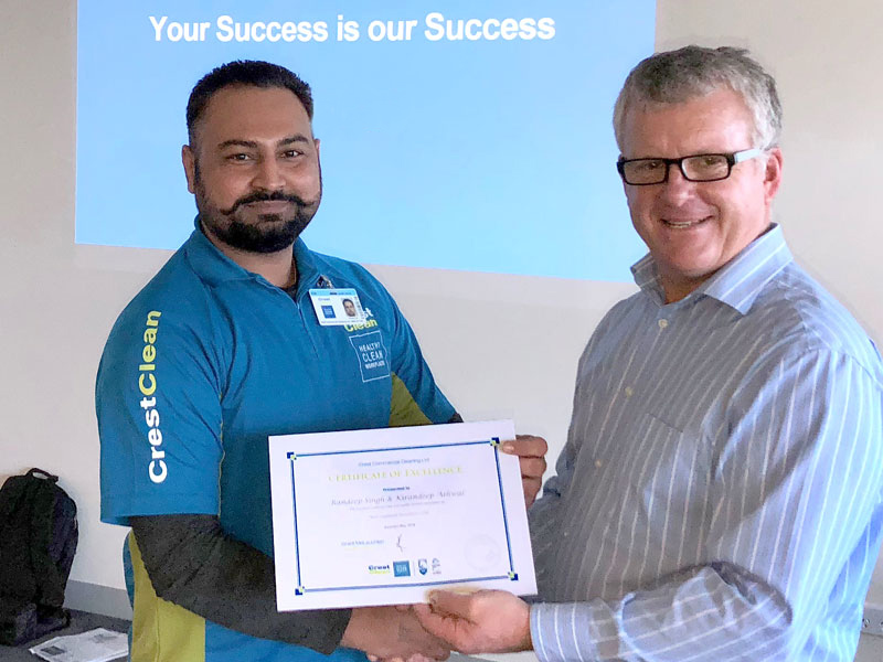 Randeep Singh receives a Certificate of Excellence award from CrestClean Managing Director Grant McLauchlan.