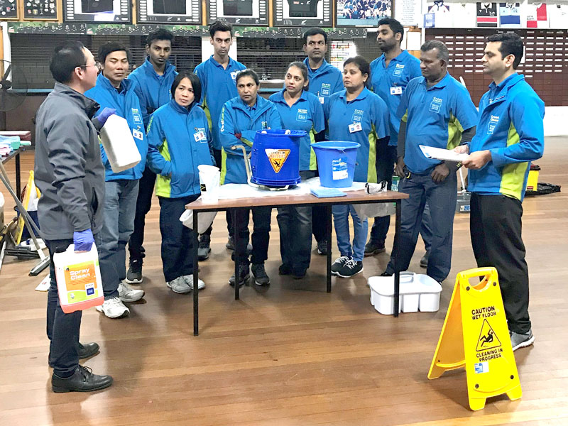 Jason Cheng (left) and Pinakin Patel with CrestClean personnel attending the training event run by the Master Cleaners Training Institute.