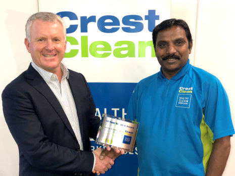 Jay Gounder receives his long service award from Grant McLauchlan, CrestClean's Managing Director.