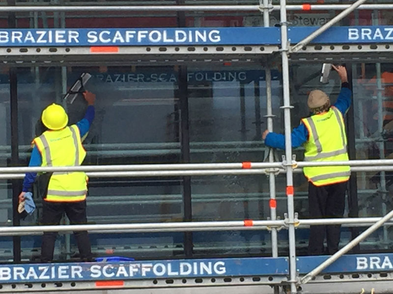 CrestClean personnel ensure the windows of Kmart's new Invercargill store look sparkling.