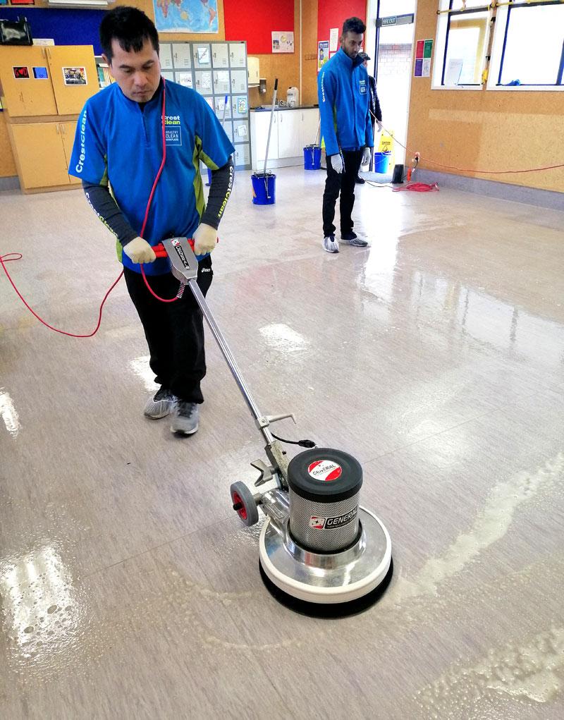 Jande Ganas learns how to strip a vinyl floor.