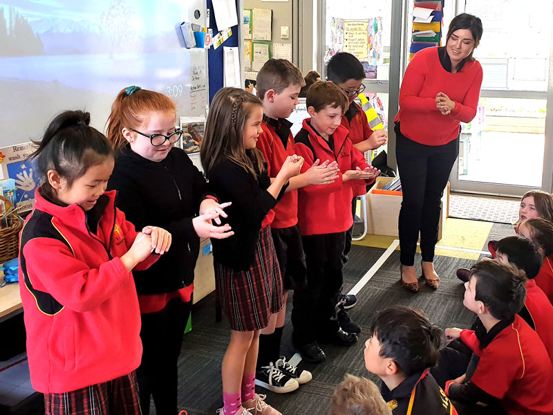 CrestClean's Gina Holland demonstrates good hand-hygiene habits to students at Halswell Primary School.