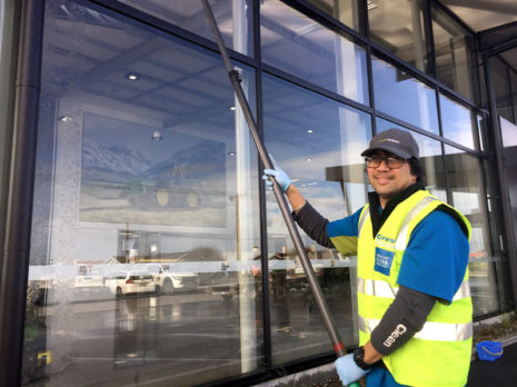 CrestClean franchisee Martin DeGuzman at work on the exterior of the Southland Farm Machinery building.