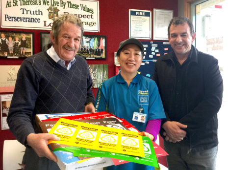 Regional Manager Glenn Cockroft and franchisee Kim Jin present a RecycleKiwi pack to Julian Ineson, Principal of Invercargill's St Theresa's School.